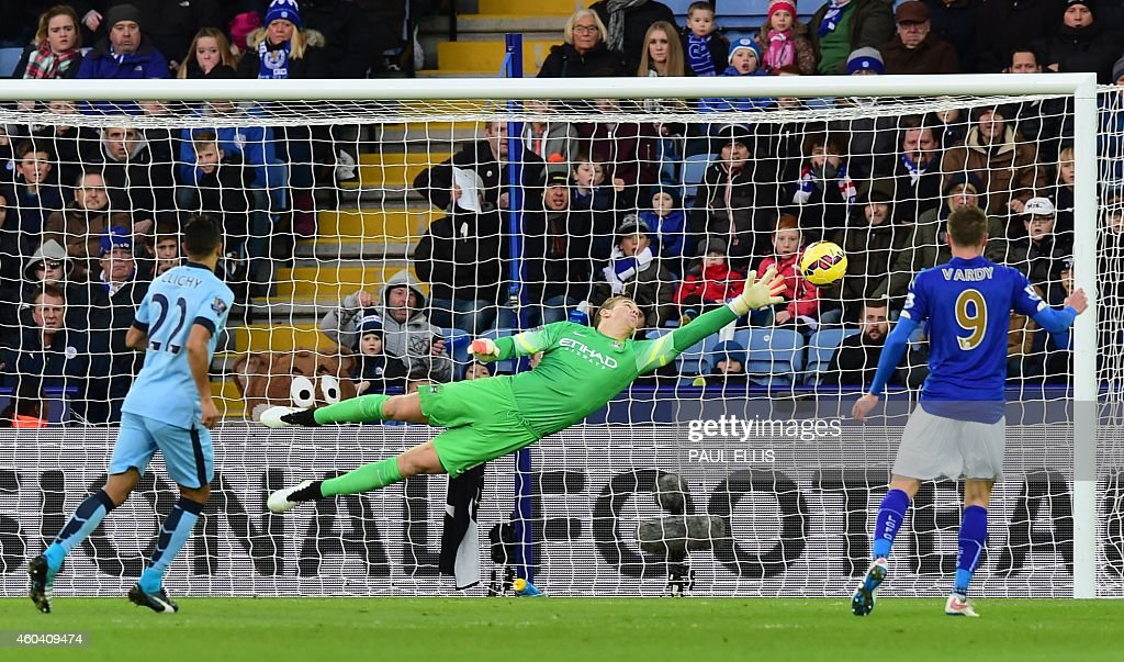 Manchester City's English goalkeeper Joe Hart dives to cover a direct free kick from Leicester City's Argentinian midfielder Esteban Cambiasso that...