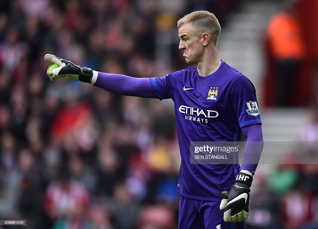 Manchester City's English goalkeeper Joe Hart gestures during the English Premier League football match between Southampton and Manchester City at St Mary's Stadium in Southampton, southern England on May 1, 2016. / AFP / BEN STANSALL / RESTRICTED TO EDITORIAL USE. No use with unauthorized audio, video, data, fixture lists, club/league logos or 'live' services. Online in-match use limited to 75 images, no video emulation. No use in betting, games or single club/league/player publications. /