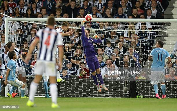 Manchester City's English goalkeeper Joe Hart punches away the ball during the English Premier League football match between West Bromwich Albion and...
