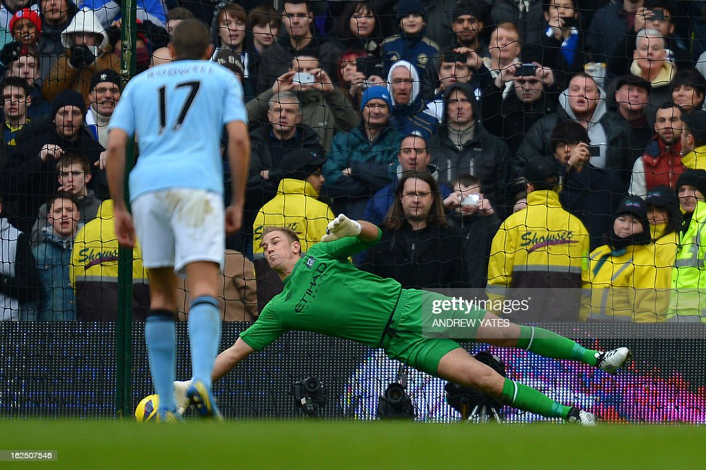 "Manchester City's English goalkeeper Joe Hart saves a penalty kick taken by Chelsea's English midfielder Frank Lampard (not pictured) during the English Premier League football match between Manchester City and Chelsea at the Etihad Stadium in Manchester, northwest England, on February 24, 2013. AFP PHOTO/ANDREW YATES USE. No use with unauthorized audio, video, data, fixture lists, club/league logos or ""live"" services. Online in-match use limited to 45 images, no video emulation. No use in betting, games or single club/league/player publications."