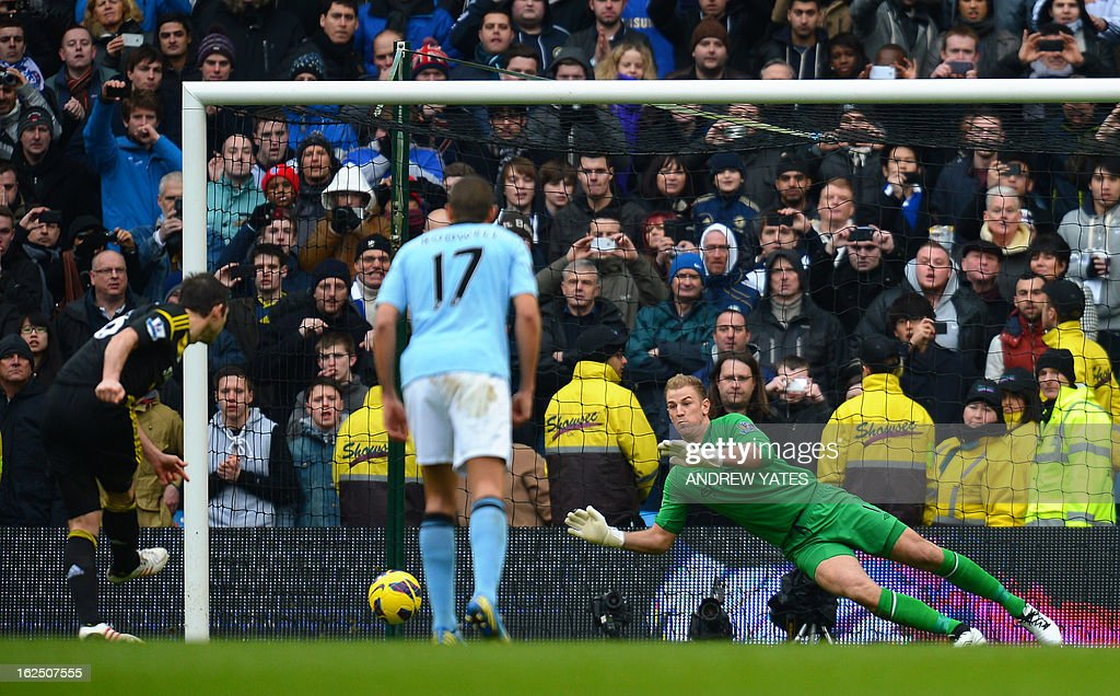 "Manchester City's English goalkeeper Joe Hart (R) saves a penalty kick taken by Chelsea's English midfielder Frank Lampard (not pictured) during the English Premier League football match between Manchester City and Chelsea at the Etihad Stadium in Manchester, northwest England, on February 24, 2013. USE. No use with unauthorized audio, video, data, fixture lists, club/league logos or ""live"" services. Online in-match use limited to 45 images, no video emulation. No use in betting, games or single club/league/player publications."