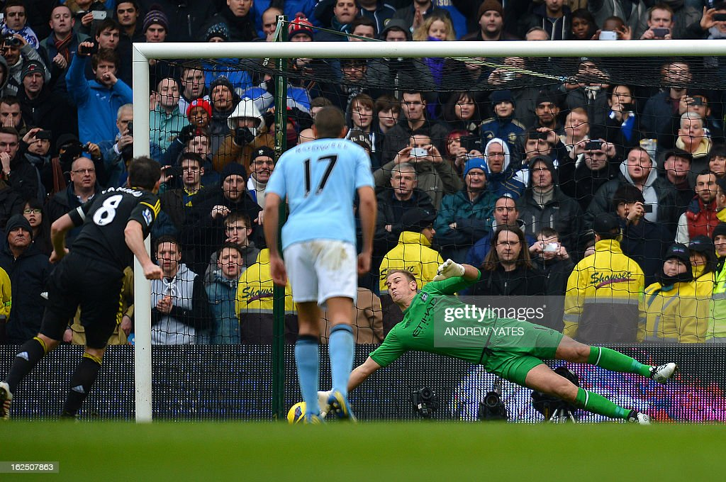 "Manchester City's English goalkeeper Joe Hart saves a penalty kick taken by Chelsea's English midfielder Frank Lampard (L) during the English Premier League football match between Manchester City and Chelsea at the Etihad Stadium in Manchester, northwest England, on February 24, 2013. USE. No use with unauthorized audio, video, data, fixture lists, club/league logos or ""live"" services. Online in-match use limited to 45 images, no video emulation. No use in betting, games or single club/league/player publications."