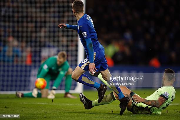 Manchester City's English goalkeeper Joe Hart saves a shot by Leicester City's English striker Jamie Vardy as Manchester City's Argentinian defender...