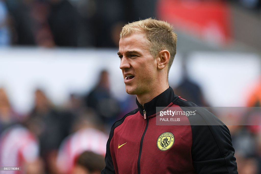 Manchester City's English goalkeeper Joe Hart walks to the dressing room at half time during the English Premier League football match between Stoke...