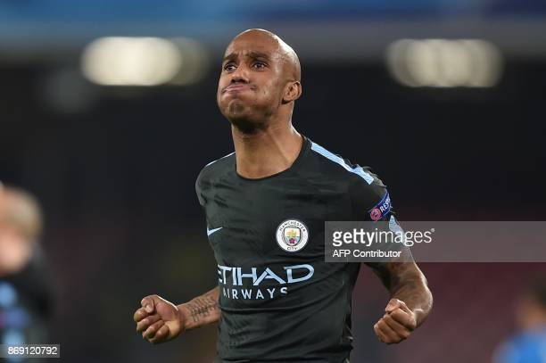 Manchester City's English midfielder Fabian Delph celebrates at the end of the UEFA Champions League football match Napoli vs Manchester City on...