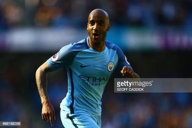 Manchester City's English midfielder Fabian Delph celebrates scoring his team's third goal during the English Premier League football match between...
