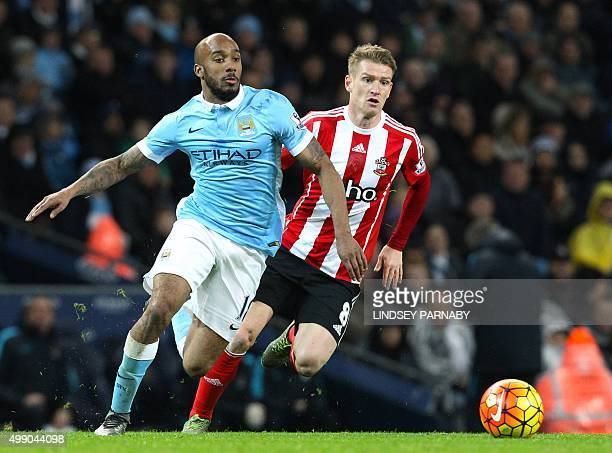 Manchester City's English midfielder Fabian Delph vies with Southampton's Northern Irish midfielder Steven Davis during the English Premier League...
