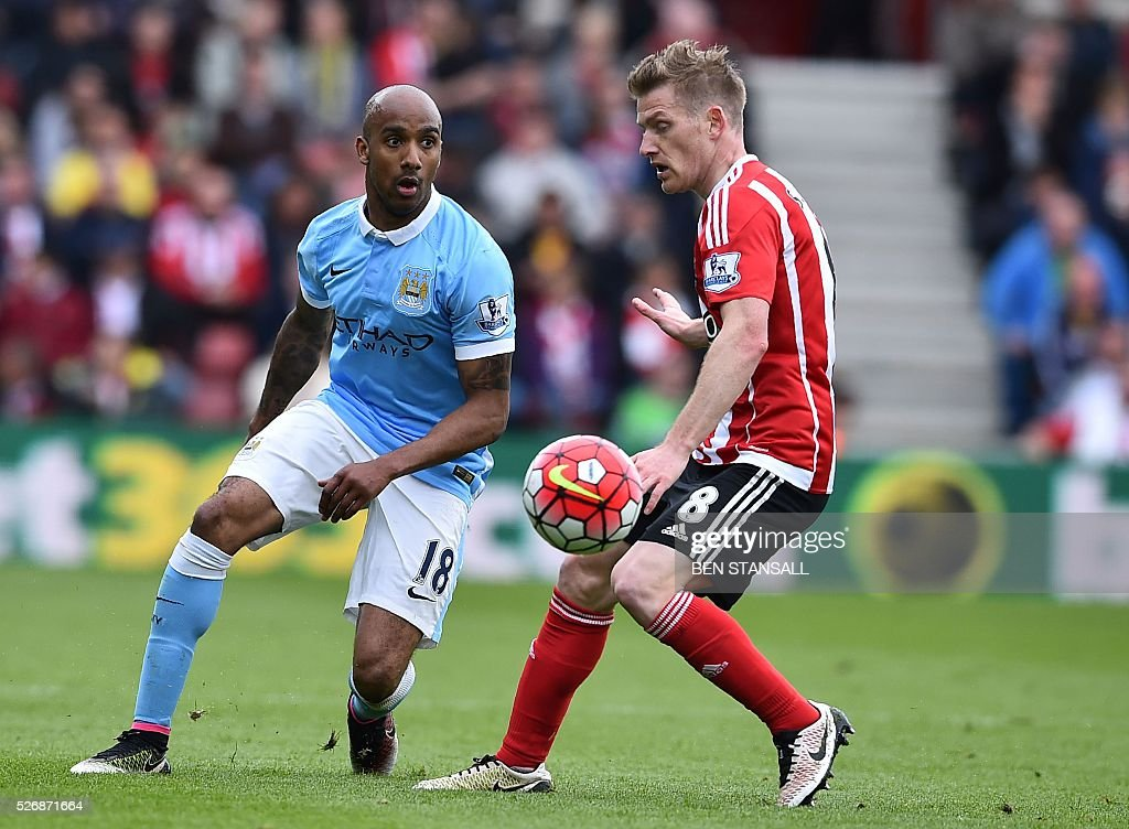 Manchester City's English midfielder Fabian Delph (L) vies with Southampton's Northern Irish midfielder Steven Davis during the English Premier League football match between Southampton and Manchester City at St Mary's Stadium in Southampton, southern England on May 1, 2016. / AFP / BEN STANSALL / RESTRICTED TO EDITORIAL USE. No use with unauthorized audio, video, data, fixture lists, club/league logos or 'live' services. Online in-match use limited to 75 images, no video emulation. No use in betting, games or single club/league/player publications. /