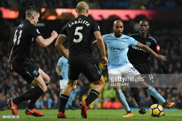 Manchester City's English midfielder Fabian Delph vies with West Ham United's Irish defender Declan Rice West Ham United's Argentinian defender Pablo...