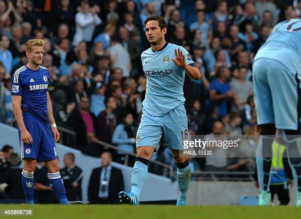 Manchester City's English midfielder Frank Lampard acknowledges the crowd after scoring his goal during the English Premier League football match...