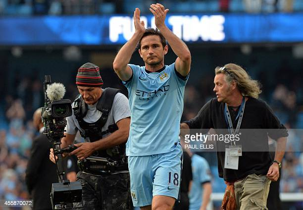 Manchester City's English midfielder Frank Lampard applauds the Chelsea supporters after the English Premier League football match between Manchester...