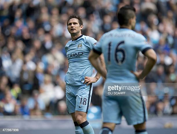 Manchester City's English midfielder Frank Lampard watches an action replay on a screen above the fans during the English Premier League football...