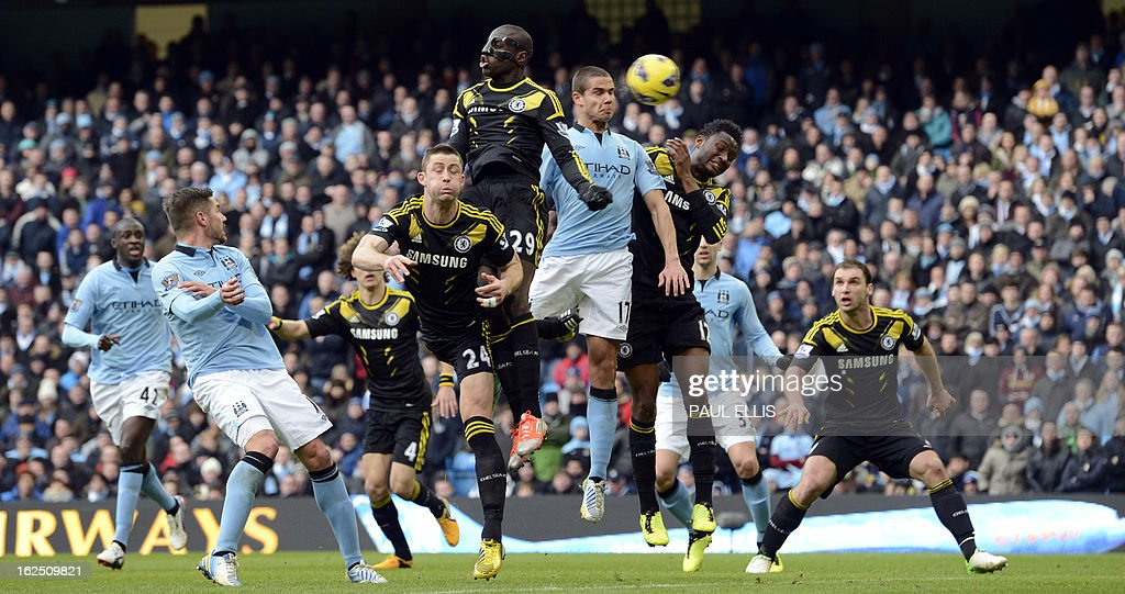 "Manchester City's English midfielder Jack Rodwell (4th R) climbs to contest a header with Chelsea's French-born Senegalese striker Demba Ba (C) during the English Premier League football match between Manchester City and Chelsea at the Etihad Stadium in Manchester, northwest England, on February 24, 2013. USE. No use with unauthorized audio, video, data, fixture lists, club/league logos or ""live"" services. Online in-match use limited to 45 images, no video emulation. No use in betting, games or single club/league/player publications."