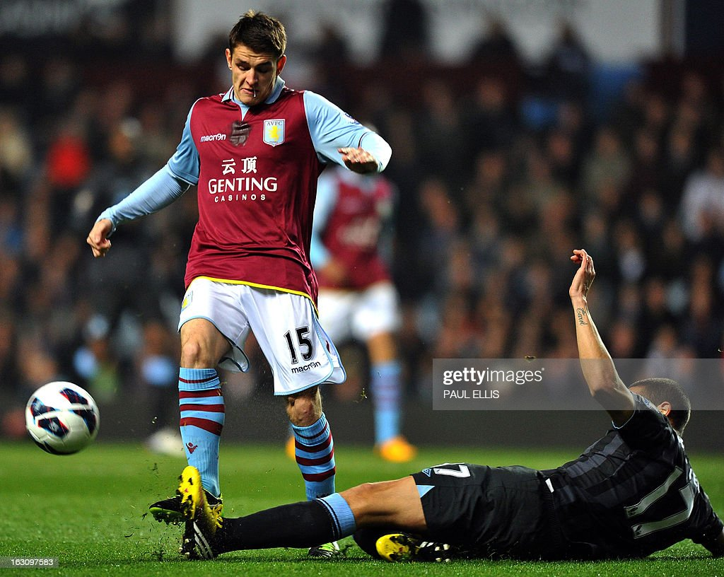 Manchester City's English midfielder Jack Rodwell (R) falls to the ground as he vies with Aston Villa's English midfielder Ashley Westwood during the English Premier League football match between Aston Villa and Manchester City at Villa Park in Birmingham, central England, on March 4, 2013. AFP PHOTO/Paul Ellis