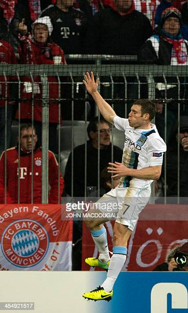 Manchester City's English midfielder James Milner celebrates after scoring during the UEFA Champions League group D football match Bayern Munich vs...