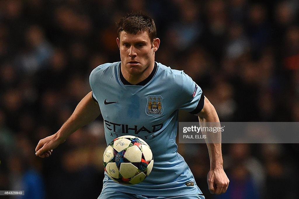 Manchester City's English midfielder <a gi-track='captionPersonalityLinkClicked' href=/galleries/search?phrase=James+Milner&family=editorial&specificpeople=214576 ng-click='$event.stopPropagation()'>James Milner</a> controls the ball during the UEFA Champions League round of 16 first leg football match between Manchester City and Barcelona at the Etihad Stadium in Manchester, northwest England, on February 24, 2015. AFP PHOTO / PAUL ELLIS