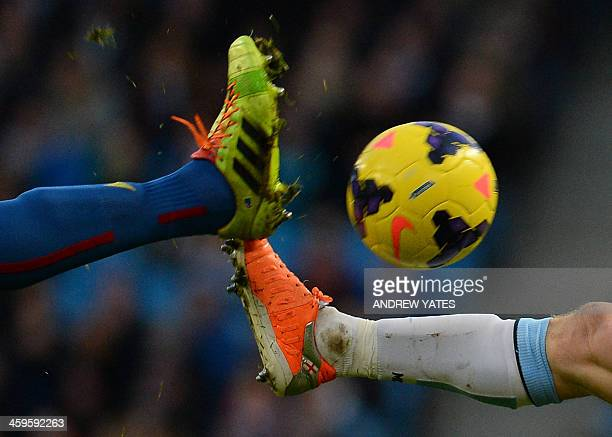 Manchester City's English midfielder James Milner vies with Crystal Palaces Australian midfielder Mile Jedinak during the English Premier League...
