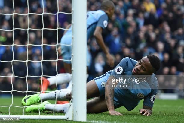 Manchester City's English midfielder Raheem Sterling and Manchester City's Brazilian midfielder Fernandinho react after failing to convert a good...