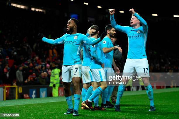 Manchester City's English midfielder Raheem Sterling and Manchester City's Belgian midfielder Kevin De Bruyne celebrate at the end during the English...