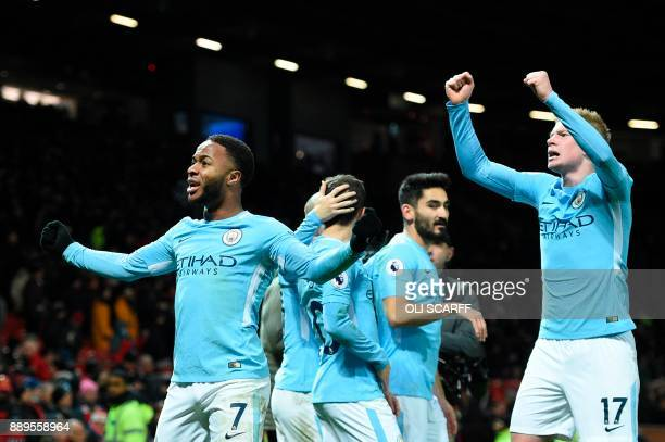 Manchester City's English midfielder Raheem Sterling and Manchester City's Belgian midfielder Kevin De Bruyne celebrate at the end of the English...