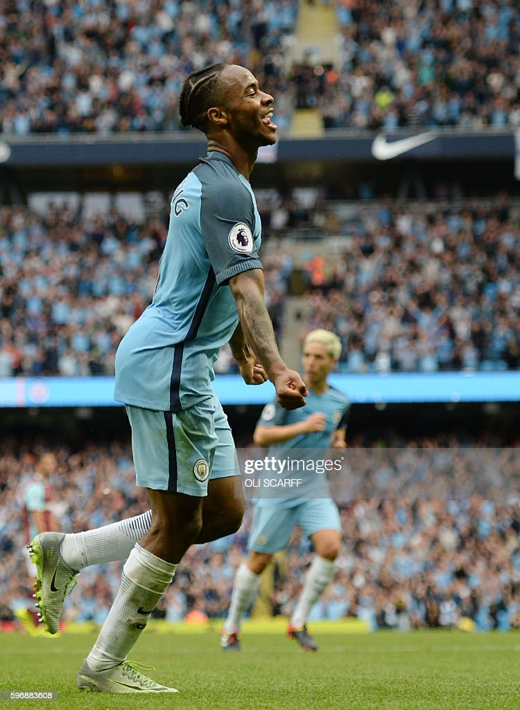 Manchester City's English midfielder Raheem Sterling celebrates after scoring during the English Premier League football match between Manchester...