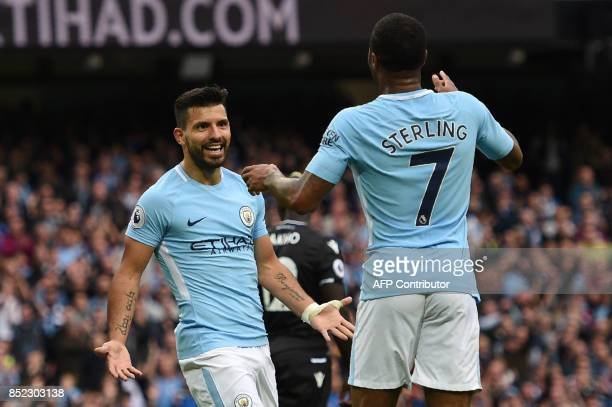 Manchester City's English midfielder Raheem Sterling celebrates after scoring his secong goal with Manchester City's Argentinian striker Sergio...
