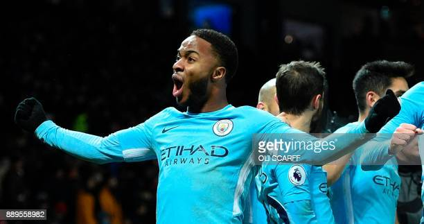 Manchester City's English midfielder Raheem Sterling celebrates at the end of the English Premier League football match between Manchester United and...
