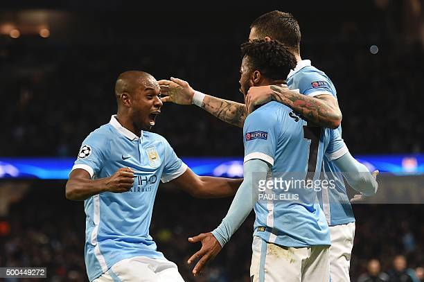 Manchester City's English midfielder Raheem Sterling celebrates scoring his second and City's third goal to take the lead 32 with Manchester City's...
