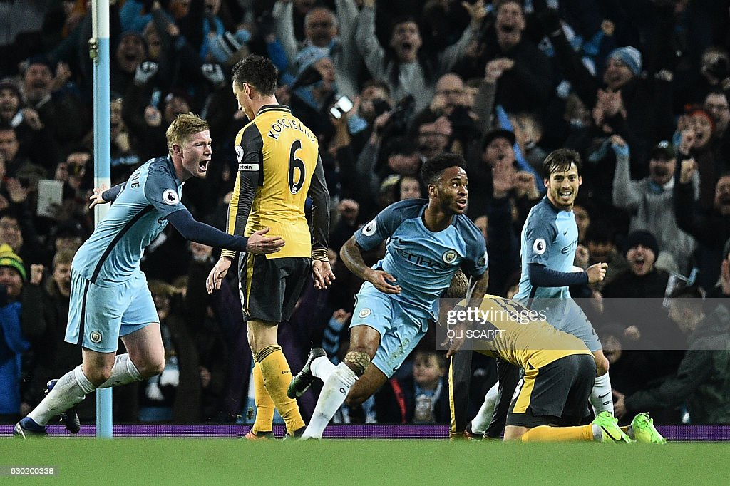 Manchester City's English midfielder Raheem Sterling (C) celebrates scoring his team's second goal during the English Premier League football match between Manchester City and Arsenal at the Etihad Stadium in Manchester, north west England, on December 18, 2016. / AFP / Oli SCARFF / RESTRICTED TO EDITORIAL USE. No use with unauthorized audio, video, data, fixture lists, club/league logos or 'live' services. Online in-match use limited to 75 images, no video emulation. No use in betting, games or single club/league/player publications. /