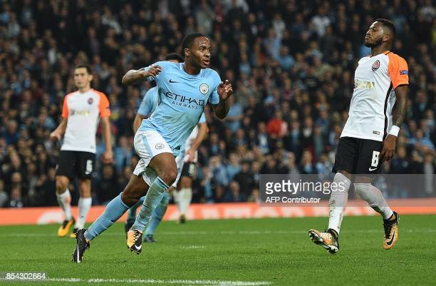 Manchester City's English midfielder Raheem Sterling celebrates scoring his team's second goal during the Group F football match between Manchester...