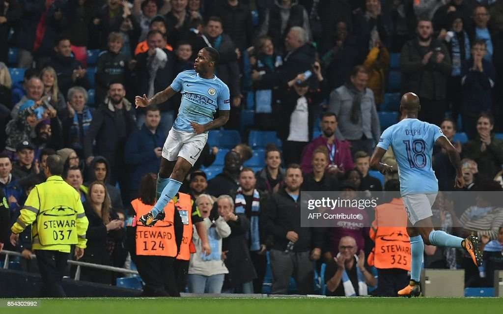 Manchester City's English midfielder Raheem Sterling celebrates scoring his team's second goal during the Group F football match between Manchester City and Shakhtar Donetsk at the Etihad Stadium in Manchester, north west England, on September 26, 2017. / AFP PHOTO / Paul ELLIS