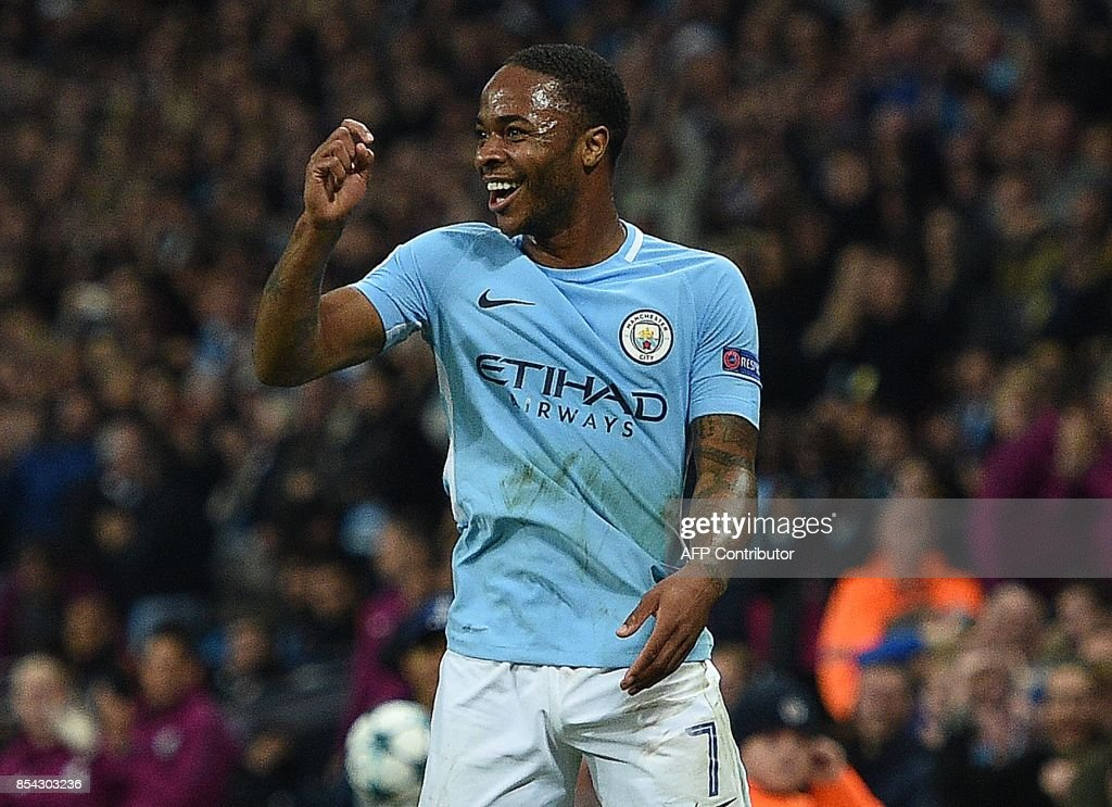 Manchester City's English midfielder Raheem Sterling celebrates scoring his team's second goal during the Group F football match between Manchester City and Shakhtar Donetsk at the Etihad Stadium in Manchester, north west England, on September 26, 2017. / AFP PHOTO / Oli SCARFF