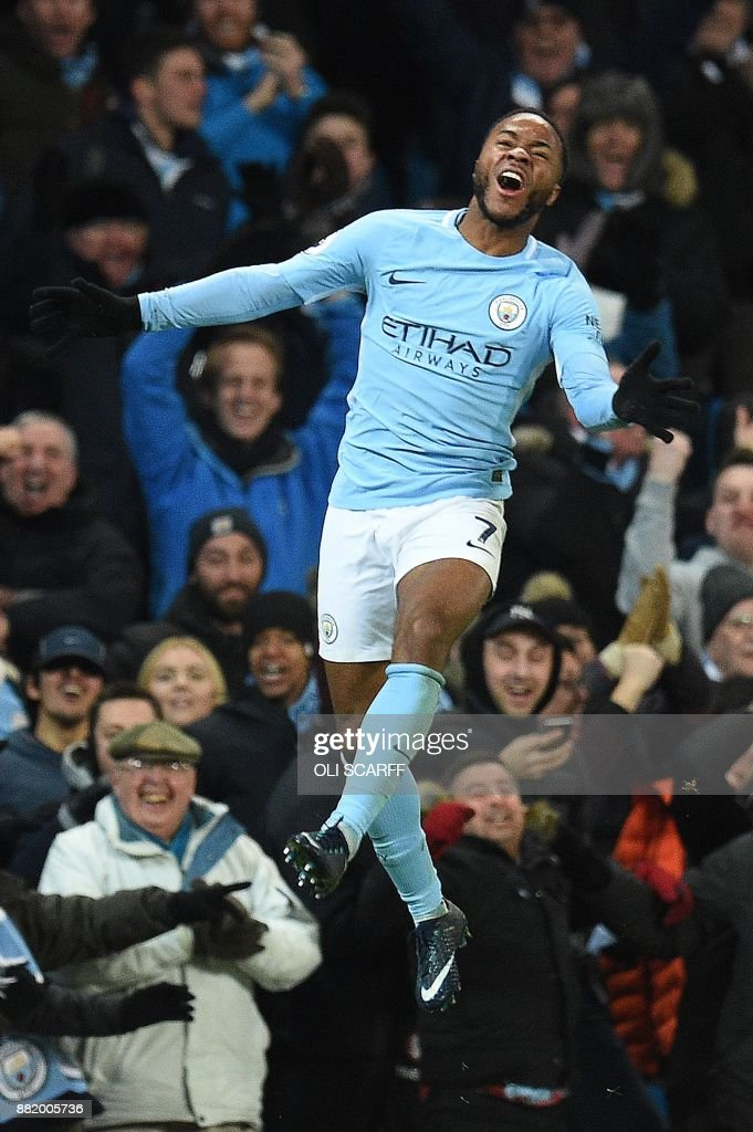 Manchester City's English midfielder Raheem Sterling celebrates scoring his team's second goal during the English Premier League football match between Manchester City and Southampton at the Etihad Stadium in Manchester, north west England, on November 29, 2017. Manchester City won the match 2-1. / AFP PHOTO / Oli SCARFF / RESTRICTED TO EDITORIAL USE. No use with unauthorized audio, video, data, fixture lists, club/league logos or 'live' services. Online in-match use limited to 75 images, no video emulation. No use in betting, games or single club/league/player publications. /