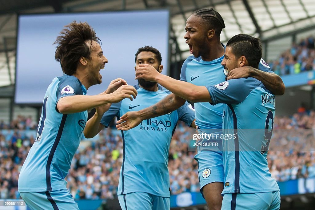 Manchester City's English midfielder Raheem Sterling (2nd R) celebrates with Manchester City's Spanish midfielder David Silva (L), Manchester City's French defender Gael Clichy and Manchester City's Spanish midfielder Nolito (R) after scoring their opening goal during the English Premier League football match between Manchester City and West Ham United at the Etihad Stadium in Manchester, north west England, on August 28, 2016. / AFP / JON SUPER / RESTRICTED TO EDITORIAL USE. No use with unauthorized audio, video, data, fixture lists, club/league logos or 'live' services. Online in-match use limited to 75 images, no video emulation. No use in betting, games or single club/league/player publications. /
