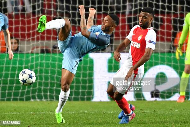 Manchester City's English midfielder Raheem Sterling challenges Monaco's French midfielder Thomas Lemar during the UEFA Champions League round of 16...