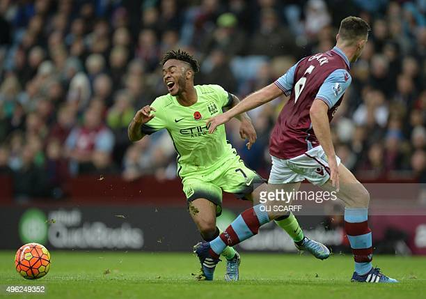 Manchester City's English midfielder Raheem Sterling falls after a challenge from Aston Villa's Englishborn Irish defender Ciaran Clark in the...