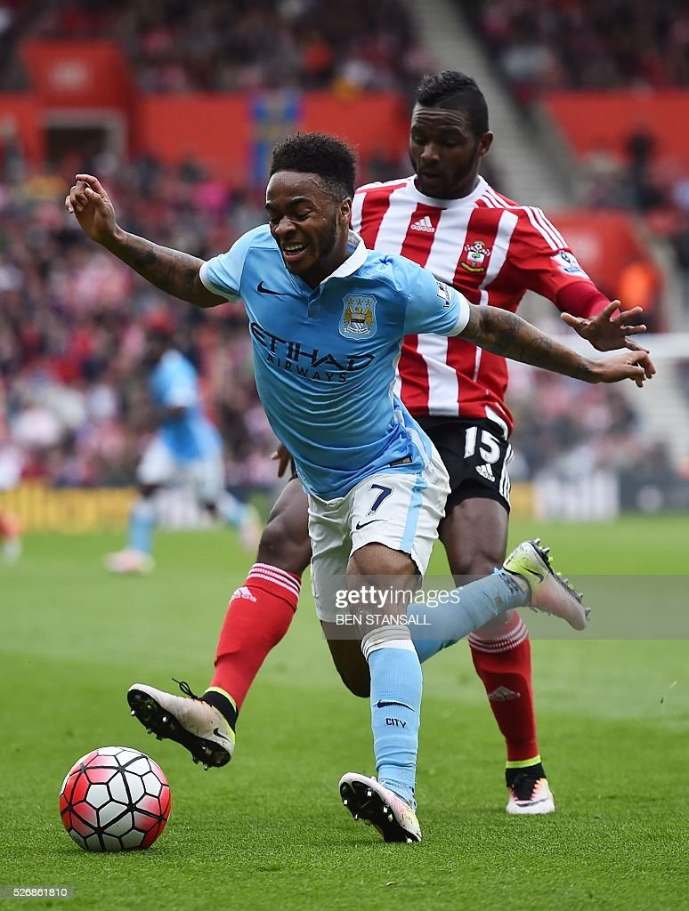 Manchester City's English midfielder Raheem Sterling (L) is chased by Southampton's Dutch-born Curacao midfielder Cuco Martina during the English Premier League football match between Southampton and Manchester City at St Mary's Stadium in Southampton, southern England on May 1, 2016. / AFP / BEN STANSALL / RESTRICTED TO EDITORIAL USE. No use with unauthorized audio, video, data, fixture lists, club/league logos or 'live' services. Online in-match use limited to 75 images, no video emulation. No use in betting, games or single club/league/player publications. /