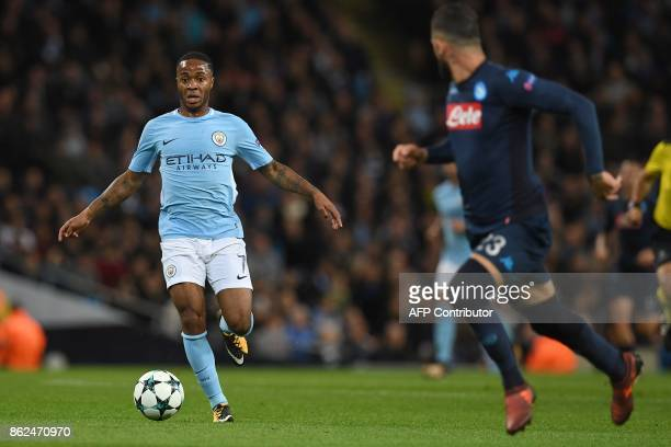 Manchester City's English midfielder Raheem Sterling runs with the ball during the UEFA Champions League Group F football match between Manchester...