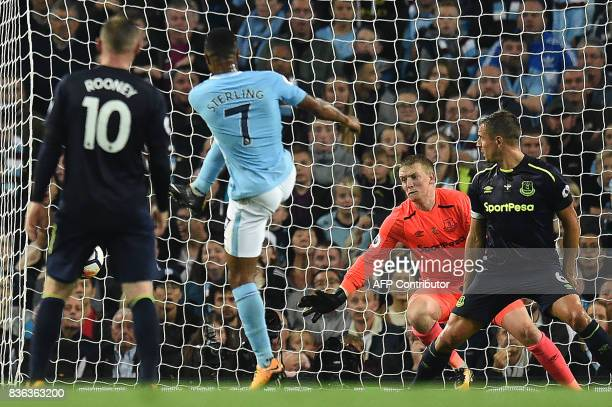 TOPSHOT Manchester City's English midfielder Raheem Sterling scores his team's first goal during the English Premier League football match between...