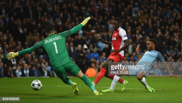 TOPSHOT Manchester City's English midfielder Raheem Sterling scores the opening goal during the UEFA Champions League Round of 16 firstleg football...