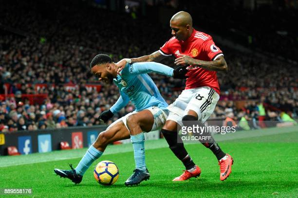 Manchester City's English midfielder Raheem Sterling tries to shield the ball from Manchester United's English midfielder Ashley Young during the...