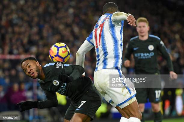 Manchester City's English midfielder Raheem Sterling vies Huddersfield Town's Dutch midfielder Rajiv van La Parra during the English Premier League...