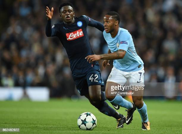 Manchester City's English midfielder Raheem Sterling vies with Napoli's Guinean midfielder Amadou Diawara during the UEFA Champions League Group F...