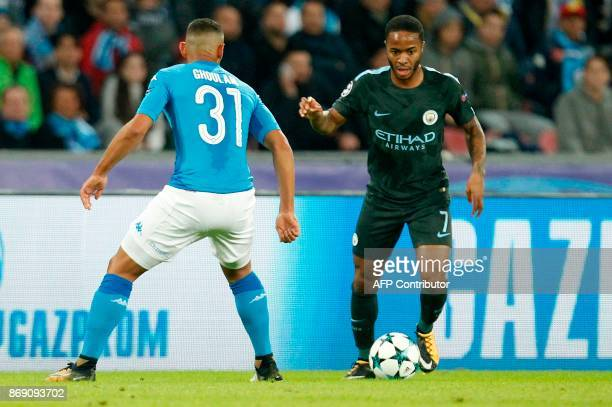 Manchester City's English midfielder Raheem Sterling vies with Napoli's defender from Algeria Faouzi Ghoulam during the UEFA Champions League...