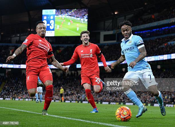 Manchester City's English midfielder Raheem Sterling vies with Liverpool's English defender Nathaniel Clyne and Liverpool's English midfielder Adam...