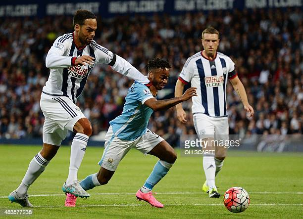 Manchester City's English midfielder Raheem Sterling vies with West Bromwich Albion's English defender Joleon Lescott during the English Premier...