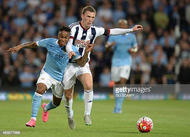 Manchester City's English midfielder Raheem Sterling vies with West Bromwich Albion's English midfielder Craig Gardner during the English Premier...