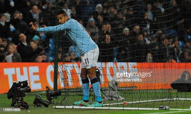Manchester City's English midfielder Scott Sinclair reacts after a missed chance during the English Premier League football match between Manchester...