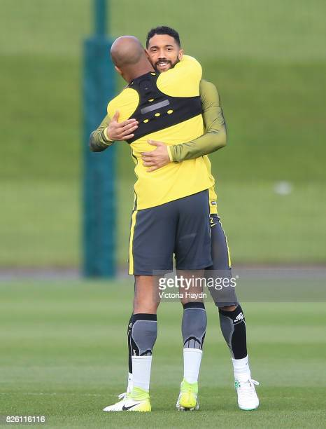 Manchester City's Fabian Delph and Gael Clichy hugging during training