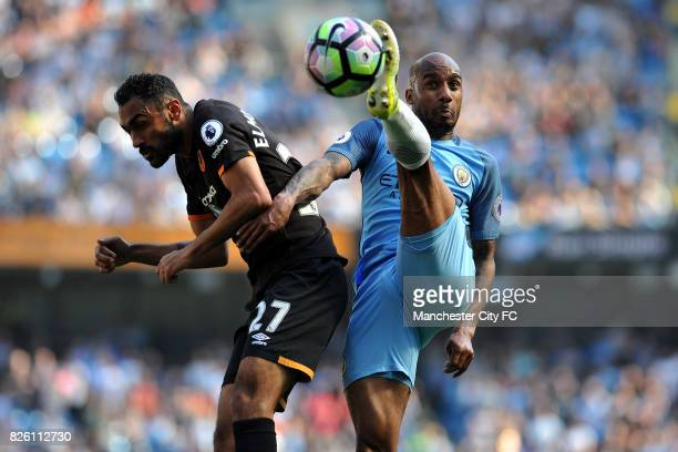 Manchester City's Fabian Delph and Hull City's Ahmed Elmohamady in action during the Barclay's Premiership match at the Etihad Stadium Manchester on...